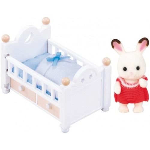 Chocolate Rabbit bébé et son lit